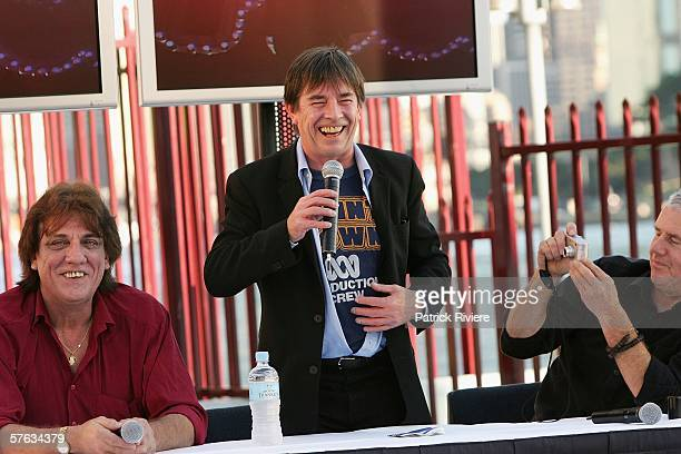 Singer John Paul Young shows the original tshirt of 'Countdown' with Jon English and Daryl Braithwaite during the launch for 'The Countdown...