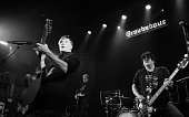 Singer John Rzeznik and bassist Robby Takac of the Goo Goo Dolls perform on stage at the Goo Goo Dolls 'Embrace the World' show to benefit Good...
