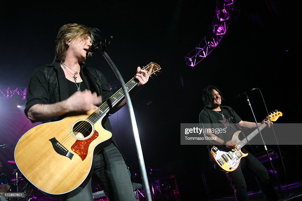 Singer John Rzeznik (L) and Robby Takac of the Goo Goo Dolls perform at the Greek Theatre on August 27, 2011 in Los Angeles, California.