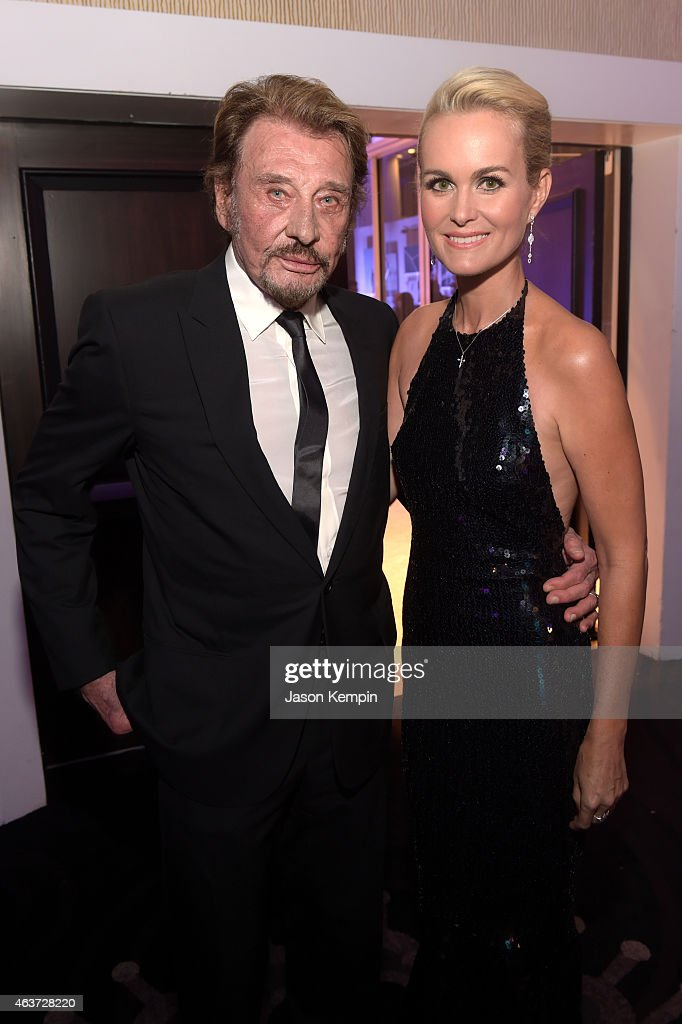 Singer Johnny Hallyday (L) and actress Laeticia Hallyday attend the 17th Costume Designers Guild Awards with presenting sponsor Lacoste at The Beverly Hilton Hotel on February 17, 2015 in Beverly Hills, California.