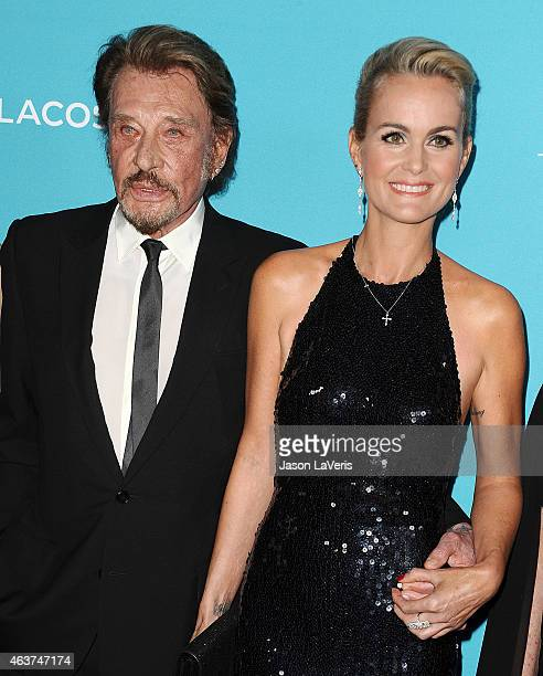 Singer Johnny Hallyday and actress Laeticia Hallyday attend the 17th Costume Designers Guild Awards at The Beverly Hilton Hotel on February 17 2015...