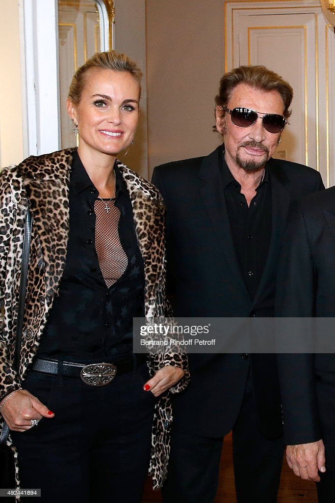 Singer Johnny Hallyday and his wife Laeticia attend Harvey Keitel receives the Medal of Commander of Arts and Letter at Ministere de la Culture on October 13, 2015 in Paris, France.
