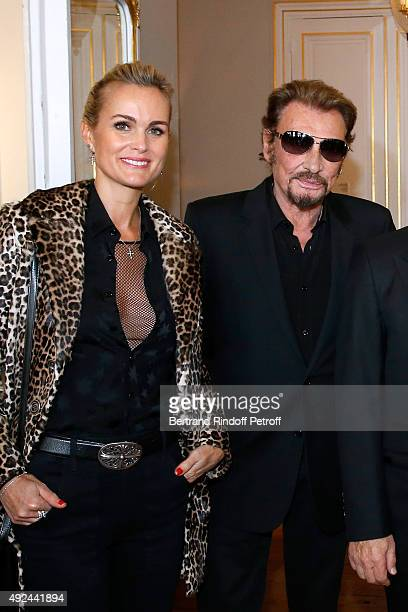 Singer Johnny Hallyday and his wife Laeticia attend Harvey Keitel receives the Medal of Commander of Arts and Letter at Ministere de la Culture on...