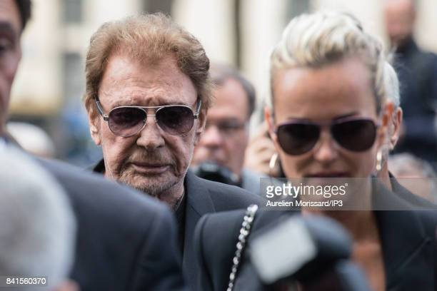 Singer Johnny Hallyday and his wife Laeticia attend Mireille Darc's Funerals at Eglise Saint Sulpice at Eglise Saint Sulpice on September 1 2017 in...