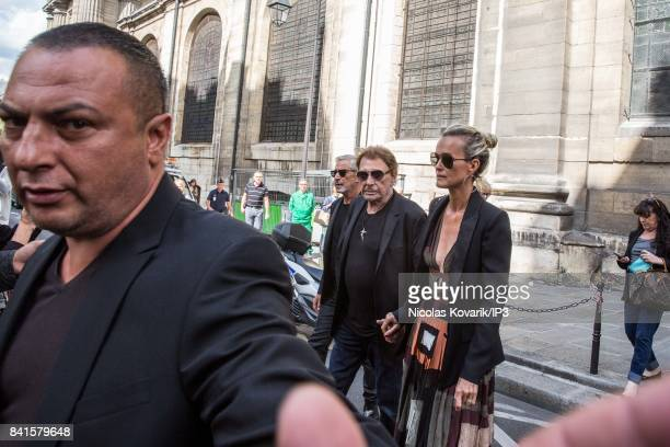 Singer Johnny Hallyday and his wife Laeticia attend Mireille Darc's Funeral at Eglise Saint Sulpice on September 1 2017 in Paris France French...