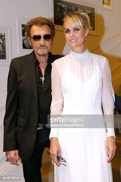 Singer Johnny Hallyday and his wife Laeticia attend the Christian Dior Haute Couture Fall/Winter 20162017 show as part of Paris Fashion Week on July...