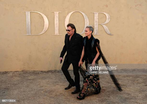 Singer Johnny Hallyday and wife Laeticia Hallyday arrive for the first cruise collection by Maria Grazia Chiuri for Dior show in the Upper Las...