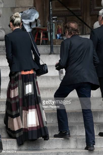 Singer Johnny Hallyday and wife Laeticia Hallyday attend actress Mireille Darc's Funeral at Eglise SaintSulpice on September 1 2017 in Paris France