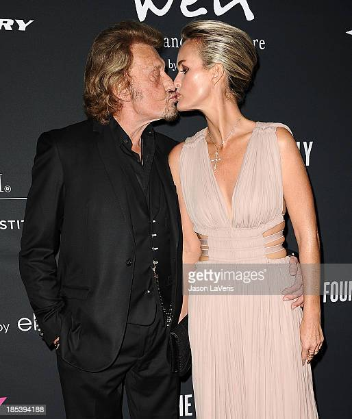 Singer Johnny Hallyday and wife Laeticia Hallyday attend the 2013 Pink Party at Hangar 8 on October 19 2013 in Santa Monica California
