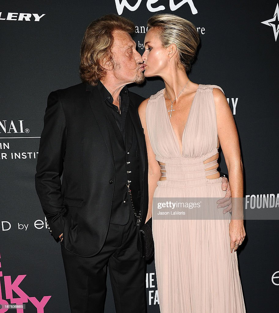 Singer <a gi-track='captionPersonalityLinkClicked' href=/galleries/search?phrase=Johnny+Hallyday&family=editorial&specificpeople=243155 ng-click='$event.stopPropagation()'>Johnny Hallyday</a> and wife <a gi-track='captionPersonalityLinkClicked' href=/galleries/search?phrase=Laeticia+Hallyday&family=editorial&specificpeople=3100080 ng-click='$event.stopPropagation()'>Laeticia Hallyday</a> attend the 2013 Pink Party at Hangar 8 on October 19, 2013 in Santa Monica, California.
