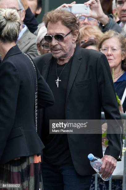 Singer Johnny Hallyday attends actress Mireille Darc's Funerals at Eglise SaintSulpice on September 1 2017 in Paris France