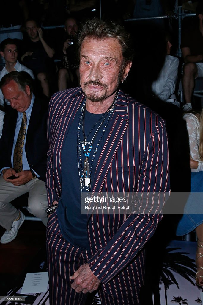 Singer <a gi-track='captionPersonalityLinkClicked' href=/galleries/search?phrase=Johnny+Hallyday&family=editorial&specificpeople=243155 ng-click='$event.stopPropagation()'>Johnny Hallyday</a> attends the Saint Laurent Menswear Spring/Summer 2016 show as part of Paris Fashion Week on June 28, 2015 in Paris, France.