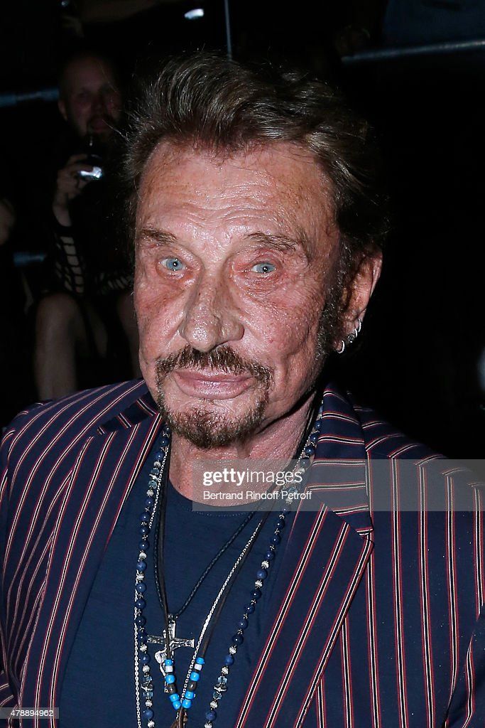 Singer Johnny Hallyday attends the Saint Laurent Menswear Spring/Summer 2016 show as part of Paris Fashion Week on June 28, 2015 in Paris, France.