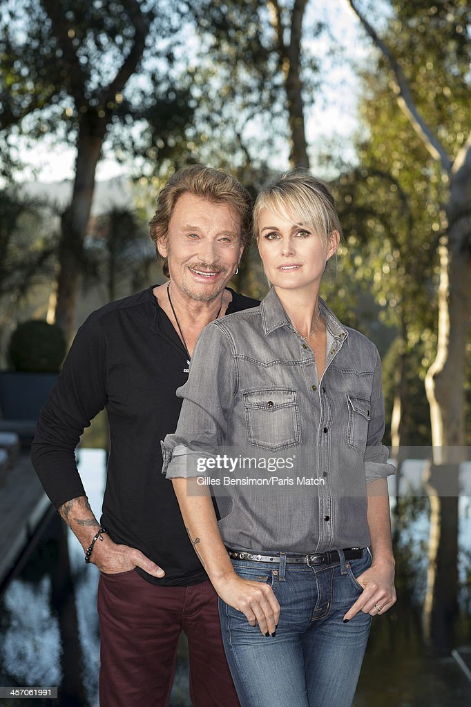 Singer Johnny Hallyday is photographed with his wife Laeticia Boudou at home for Paris Match on November 14, 2013 in Los Angeles, California.
