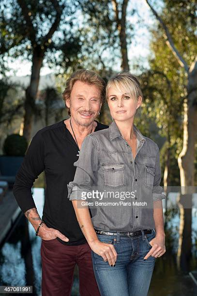 Singer Johnny Hallyday is photographed with his wife Laeticia Boudou at home for Paris Match on November 14 2013 in Los Angeles California