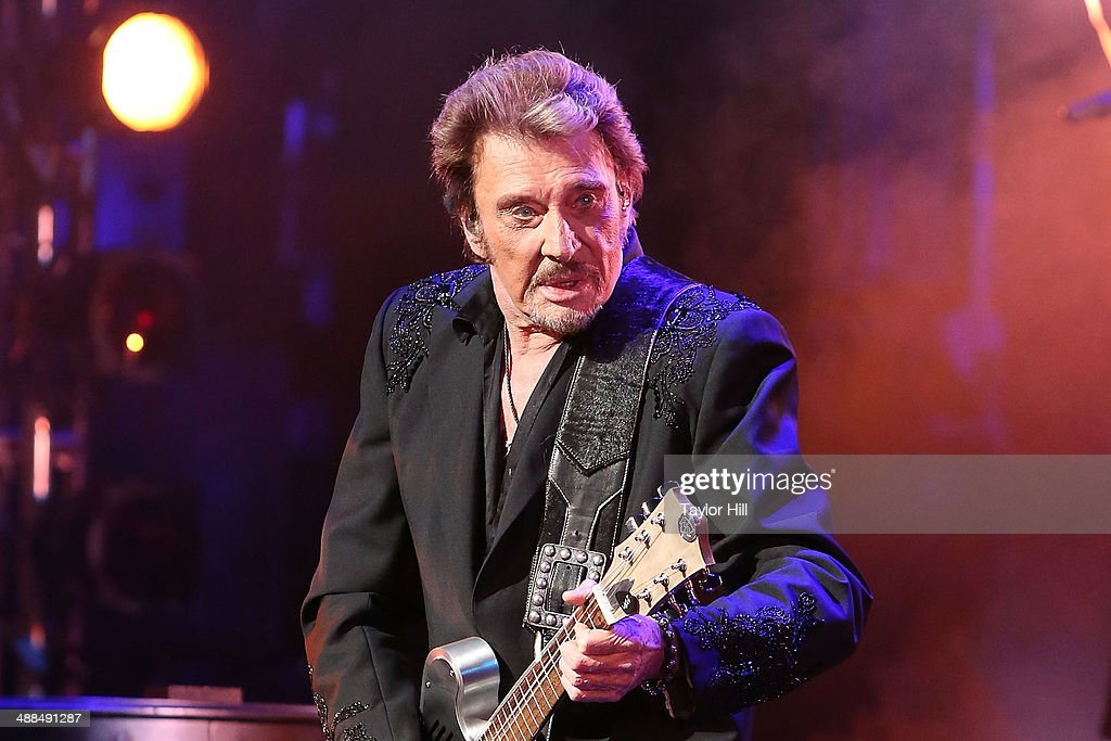 Singer <a gi-track='captionPersonalityLinkClicked' href=/galleries/search?phrase=Johnny+Hallyday&family=editorial&specificpeople=243155 ng-click='$event.stopPropagation()'>Johnny Hallyday</a> performs in concert at The Beacon Theatre on May 6, 2014 in New York City.