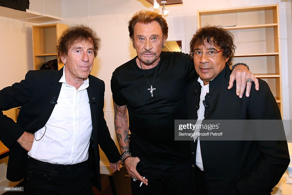 Singer Johnny Hallyday standing between Main Guests of the show, singers Alain Souchon (L) and Laurent Voulzy (R) attend the 'Vivement Dimanche' French TV Show at Pavillon Gabriel on November 19, 2014 in Paris, France.