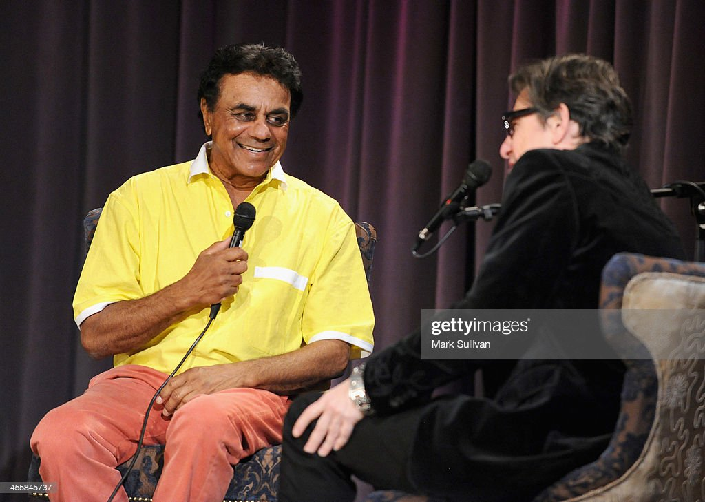 Singer <a gi-track='captionPersonalityLinkClicked' href=/galleries/search?phrase=Johnny+Mathis&family=editorial&specificpeople=597901 ng-click='$event.stopPropagation()'>Johnny Mathis</a> (L) and Vice President of the GRAMMY Foundation Scott Goldman onstage during An Evening With <a gi-track='captionPersonalityLinkClicked' href=/galleries/search?phrase=Johnny+Mathis&family=editorial&specificpeople=597901 ng-click='$event.stopPropagation()'>Johnny Mathis</a> at The GRAMMY Museum on December 12, 2013 in Los Angeles, California.