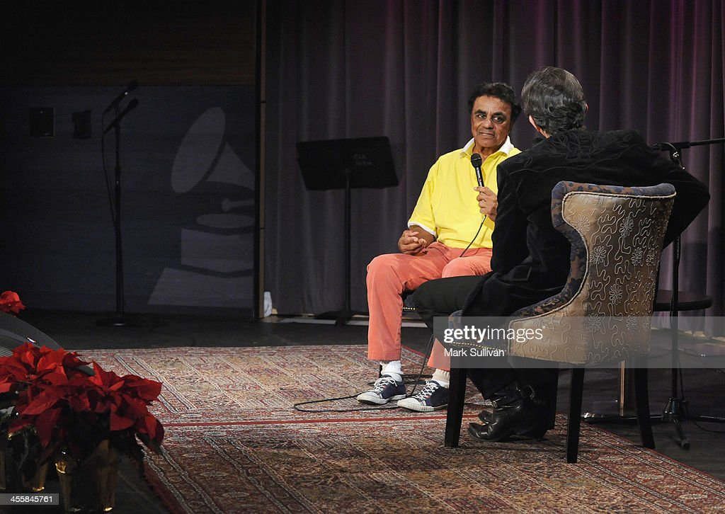 Singer Johnny Mathis (L) and Vice President of the GRAMMY Foundation Scott Goldman onstage during An Evening With Johnny Mathis at The GRAMMY Museum on December 12, 2013 in Los Angeles, California.