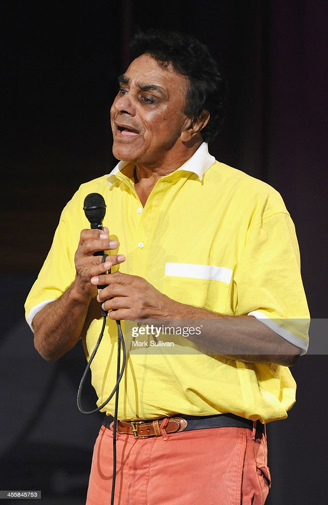 Singer <a gi-track='captionPersonalityLinkClicked' href=/galleries/search?phrase=Johnny+Mathis&family=editorial&specificpeople=597901 ng-click='$event.stopPropagation()'>Johnny Mathis</a> performs during An Evening With <a gi-track='captionPersonalityLinkClicked' href=/galleries/search?phrase=Johnny+Mathis&family=editorial&specificpeople=597901 ng-click='$event.stopPropagation()'>Johnny Mathis</a> at The GRAMMY Museum on December 12, 2013 in Los Angeles, California.