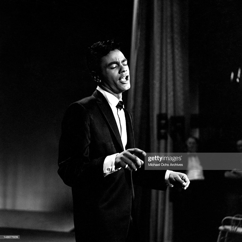 Singer Johnny Mathis performs on The Ed Sullivan on April 26 1959 in New York City New York