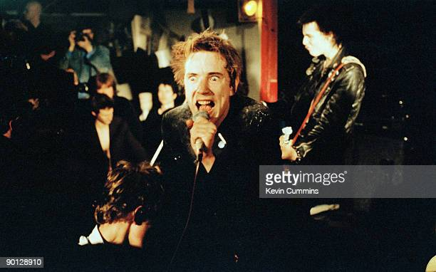 Singer Johnny Rotten and bassist Sid Vicious performing with English punk band the Sex Pistols at Ivanhoe's Huddersfield on Christmas day 1977