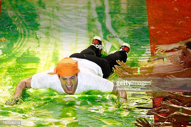 Singer Johnny Ruffo slides down slime during the Nickelodeon Slimefest 2012 evening show at Hordern Pavilion on September 15 2012 in Sydney Australia
