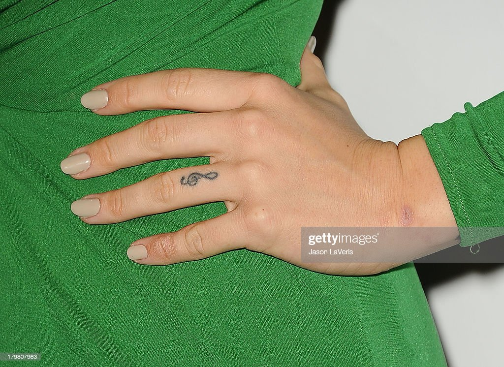 Singer JoJo (tattoo and nail detail) attends Generosity Water's 5th annual Night of Generosity benefit at Beverly Hills Hotel on September 6, 2013 in Beverly Hills, California.