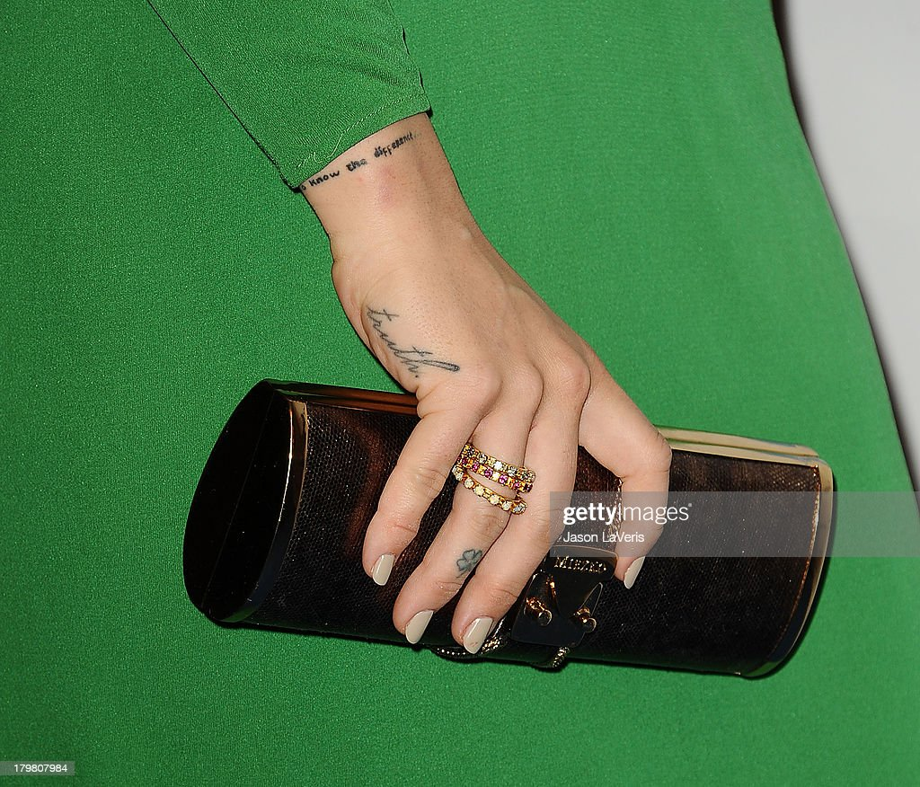 Singer JoJo (tattoo, jewelry and handbag detail) attends Generosity Water's 5th annual Night of Generosity benefit at Beverly Hills Hotel on September 6, 2013 in Beverly Hills, California.