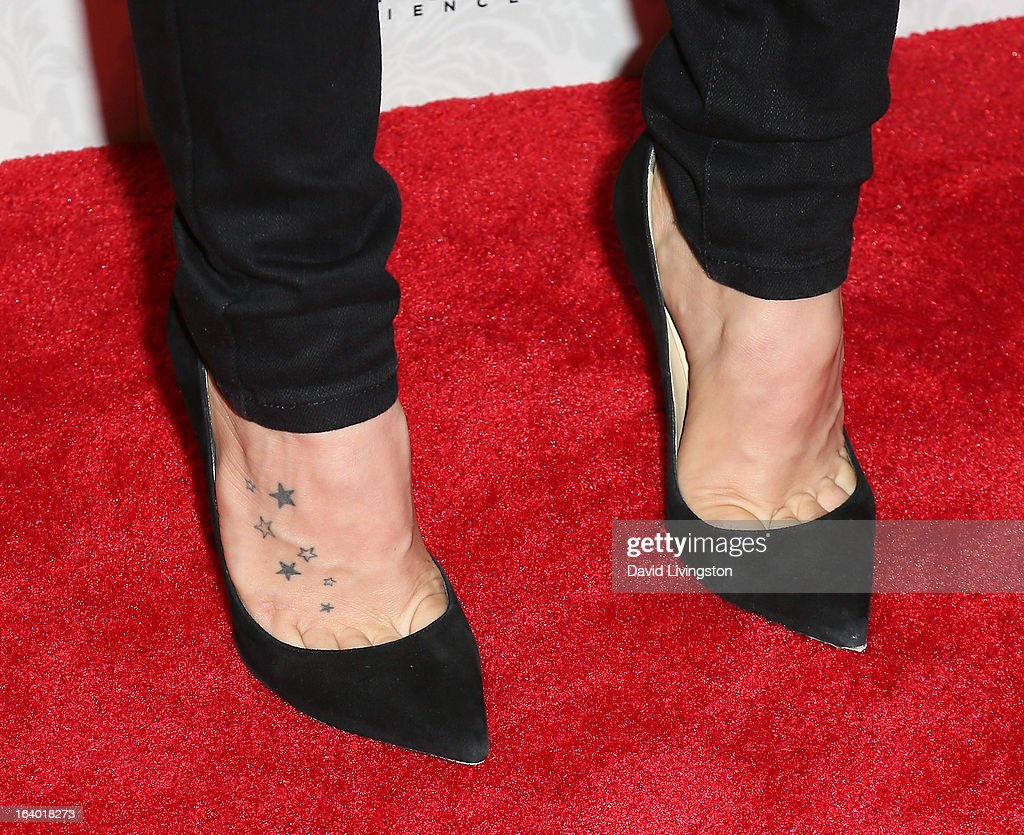Singer JoJo (shoe & tattoo detail) attends the iHeartRadio '20/20' album release party with Justin Timberlake presented by Target at the El Rey Theatre on March 18, 2013 in Los Angeles, California.