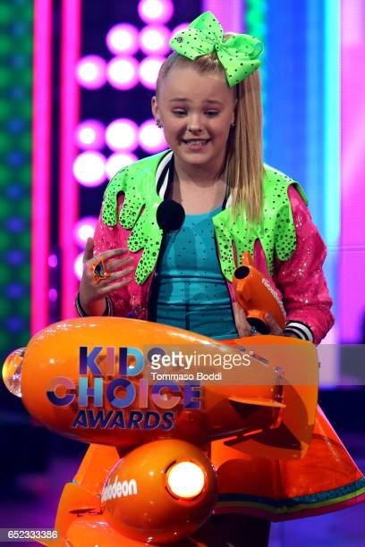 Singer JoJo Siwa accepts the award for Favorite Viral Music Artist onstage at the Nickelodeon's 2017 Kids' Choice Awards at USC Galen Center on March...