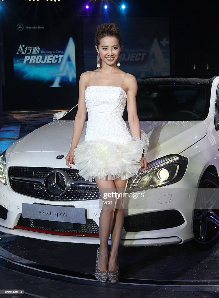 Singer <a gi-track='captionPersonalityLinkClicked' href=/galleries/search?phrase=Jolin+Tsai&family=editorial&specificpeople=647514 ng-click='$event.stopPropagation()'>Jolin Tsai</a> poses with a Mercedes-Benz A 250 Sport car during a Mercedes-Benz promotional event at the Chiang Kai-shek Memorial Hall on November 22, 2012 in Taipei, Taiwan.