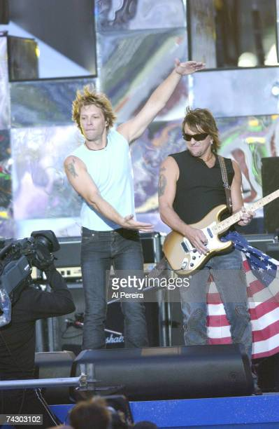 Singer Jon Bon Jovi and guitarist Richie Sambora of the hard rock group 'Bon Jovi' performs onstage during NFL Kickoff Weekend in Times Square on...
