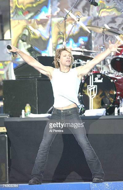 Singer Jon Bon Jovi of the hard rock group 'Bon Jovi' performs onstage during NFL Kickoff Weekend in Times Square on September 5 2002 in New York...