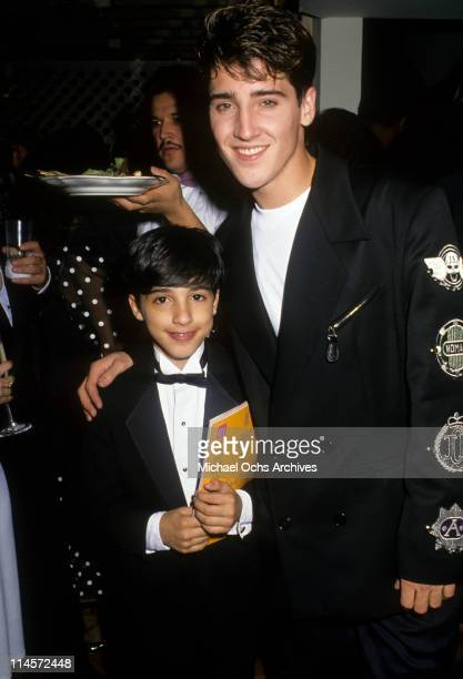 Singer Jonathan Knight of New Kids On The Block posing with a fan circa 1989