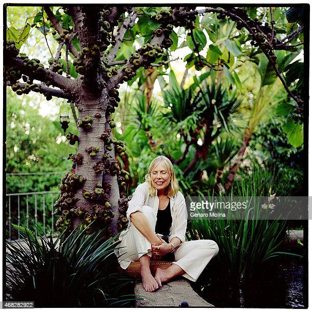 Singer Joni Mitchell sits under a fig tree in the courtyard of her Bel Air home photographed for Los Angeles Times on March 29 2004 in Beverly Hills...