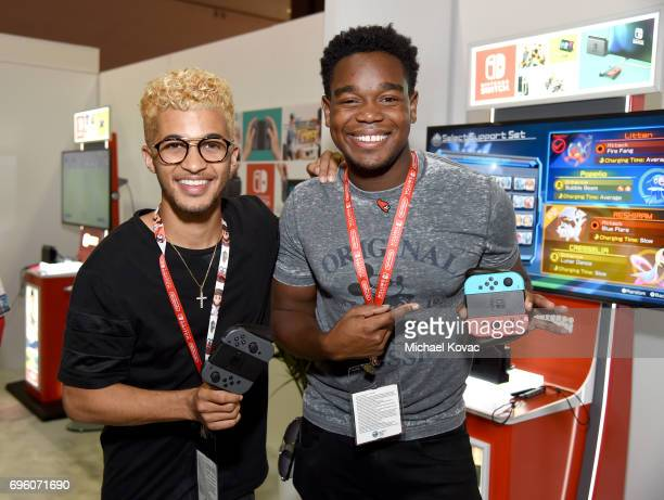 Singer Jordan Fisher and actor Dexter Darden visit the Nintendo booth at the 2017 E3 Gaming Convention at Los Angeles Convention Center on June 14...
