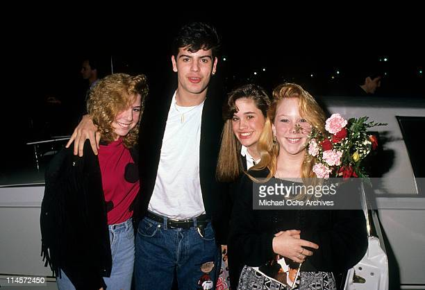 Singer Jordan Knight of New Kids On The Block posing with fans circa 1990