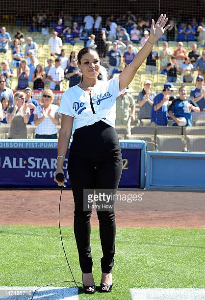 Singer Jordan Sparks waves after singing the national anthem before the game between the New York Mets and the Los Angeles Dodgers at Dodger Stadium...