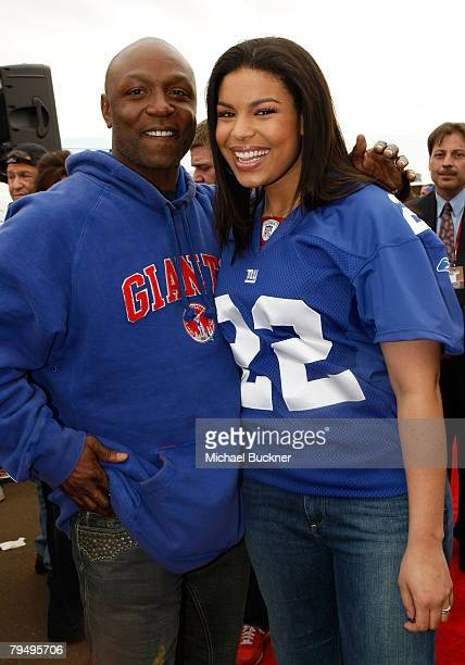Singer Jordin Sparks and father former NFL player Phillippi Sparks arrive on Fox's Super Bowl XLII red carpet on February 3 2008 at University of...