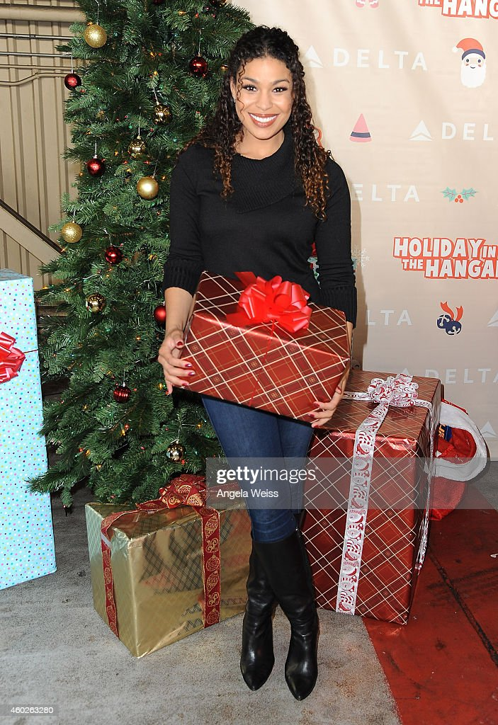 Singer Jordin Sparks attends Delta Air Lines' Annual Holiday In The Hangar Celebration at LAX Airport on December 10 2014 in Los Angeles California