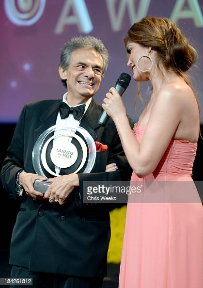 Singer José José accepts the award for Special Achievement in Music 50 Years from singer Ana Barbara onstage at the '2013 Latinos de Hoy Awards'...