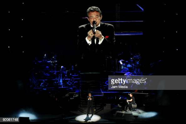Singer Jose Jose and Yanni perform during the concert Yanni Voices Tour 2009 at the Auditorio Nacional on October 19 2009 in Mexico City Mexico