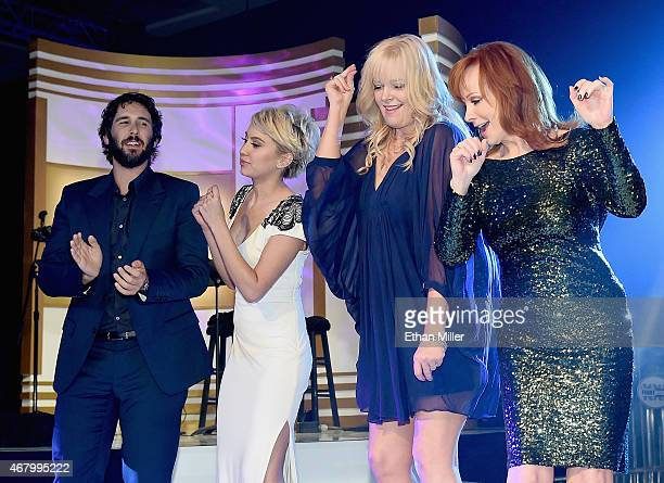 Singer Josh Groban actresses Chelsea Kane and Melissa Peterman and singer Reba McEntire perform onstage during Muhammad Ali's Celebrity Fight Night...