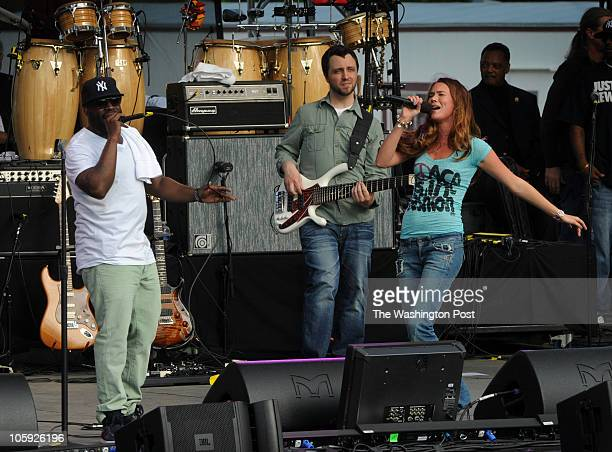 Singer Joss Stone right joins Tariq Trotter left and Owen Biddle center of the Roots during the 40th anniversary of Earth Day concert and rally on...