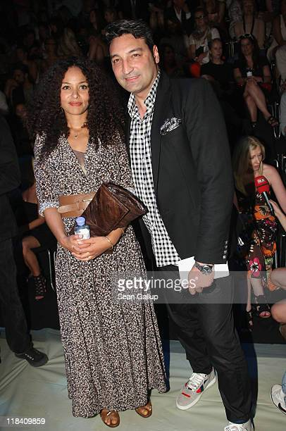 Singer Joy Denalane and Mousse T attend the Mongrels in Common Show during MercedesBenz Fashion Week Berlin Spring/Summer 2012 at the Brandenburg...
