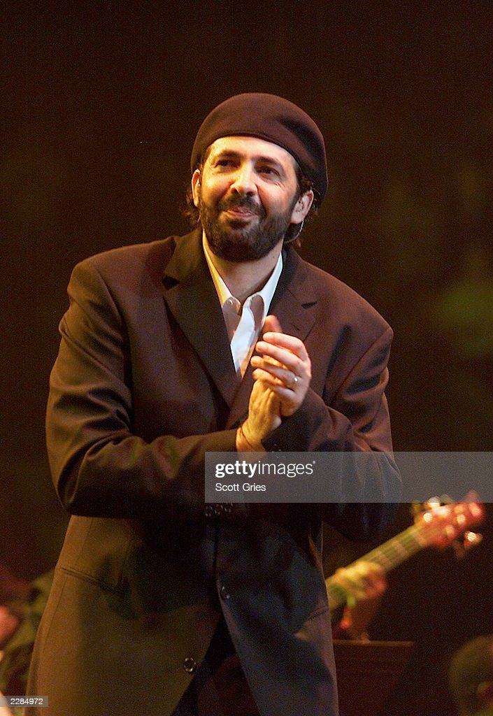 Singer <a gi-track='captionPersonalityLinkClicked' href=/galleries/search?phrase=Juan+Luis+Guerra&family=editorial&specificpeople=208921 ng-click='$event.stopPropagation()'>Juan Luis Guerra</a> at Hispanics United for New York at Madison Square Garden in New York City. The concert was a benefit to raise funds to aid the families of Flight #587 and the victims of September 11th. 12/9/01 Photo by Scott Gries/ImageDirect