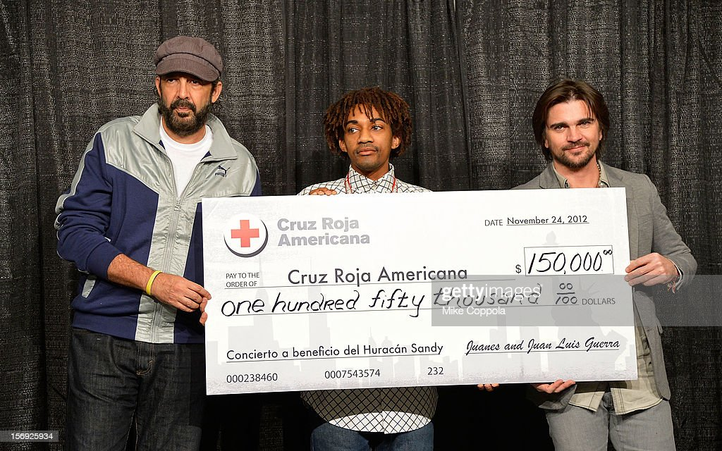 Singer Juan Luis Guerra, Jeramie Williams of the American Red Cross, and singer Juanes at Barclays Center of Brooklyn on November 24, 2012 in New York City.