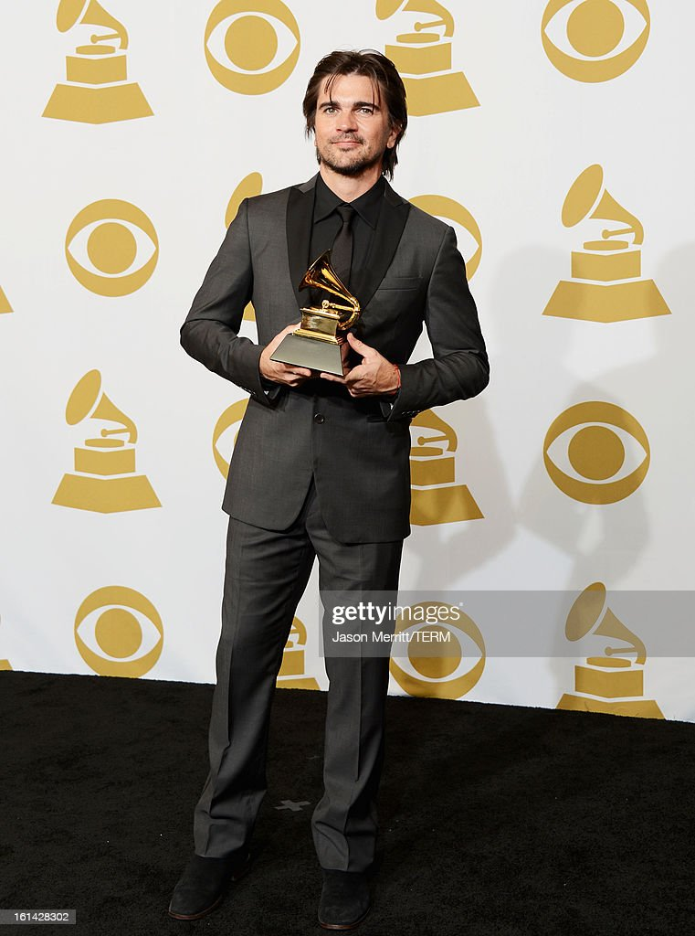 Singer Juanes, winner of Best Latin Pop Album, poses in the press room at the 55th Annual GRAMMY Awards at Staples Center on February 10, 2013 in Los Angeles, California.