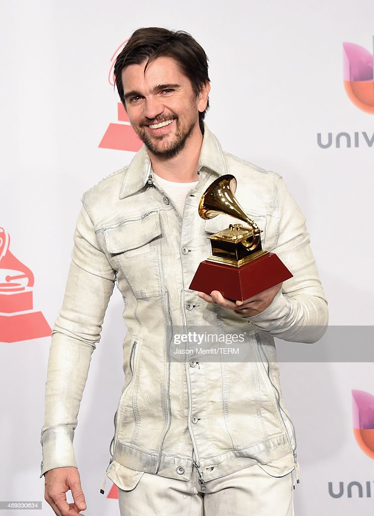 Singer <a gi-track='captionPersonalityLinkClicked' href=/galleries/search?phrase=Juanes&family=editorial&specificpeople=202467 ng-click='$event.stopPropagation()'>Juanes</a>, winner of Best Pop/Rock Album, attends the 15th Annual Latin GRAMMY Awards at the MGM Grand Garden Arena on November 20, 2014 in Las Vegas, Nevada.